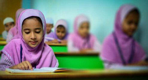 girl children reading in class